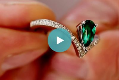 Dark Green Colombian Emeralds on a White Background - Lee Wasson