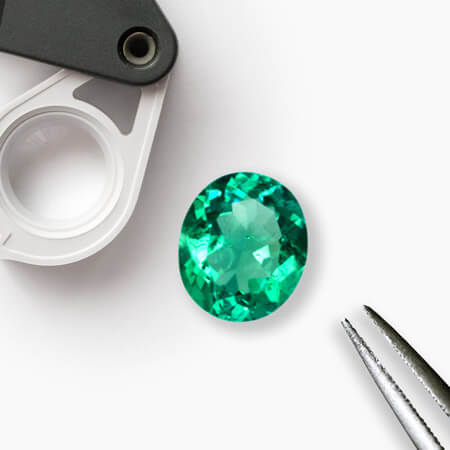 Locate Emeralds Inclusion in White Background
